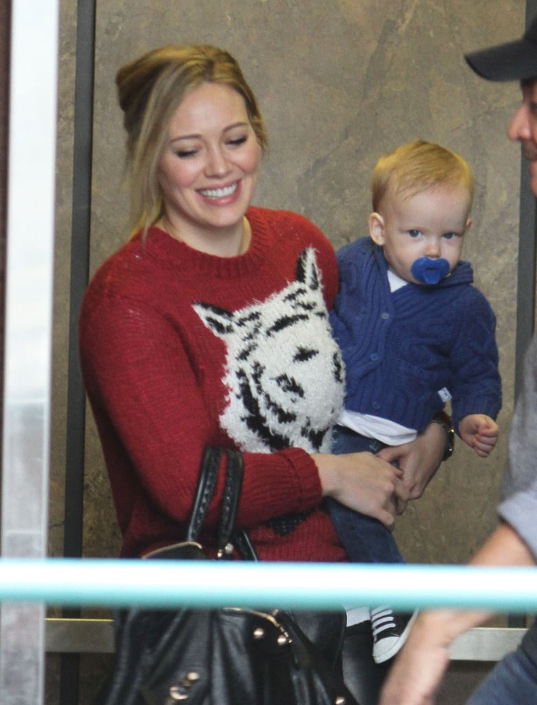 Hilary Duff was all smiles as she carried Luca Comrie.