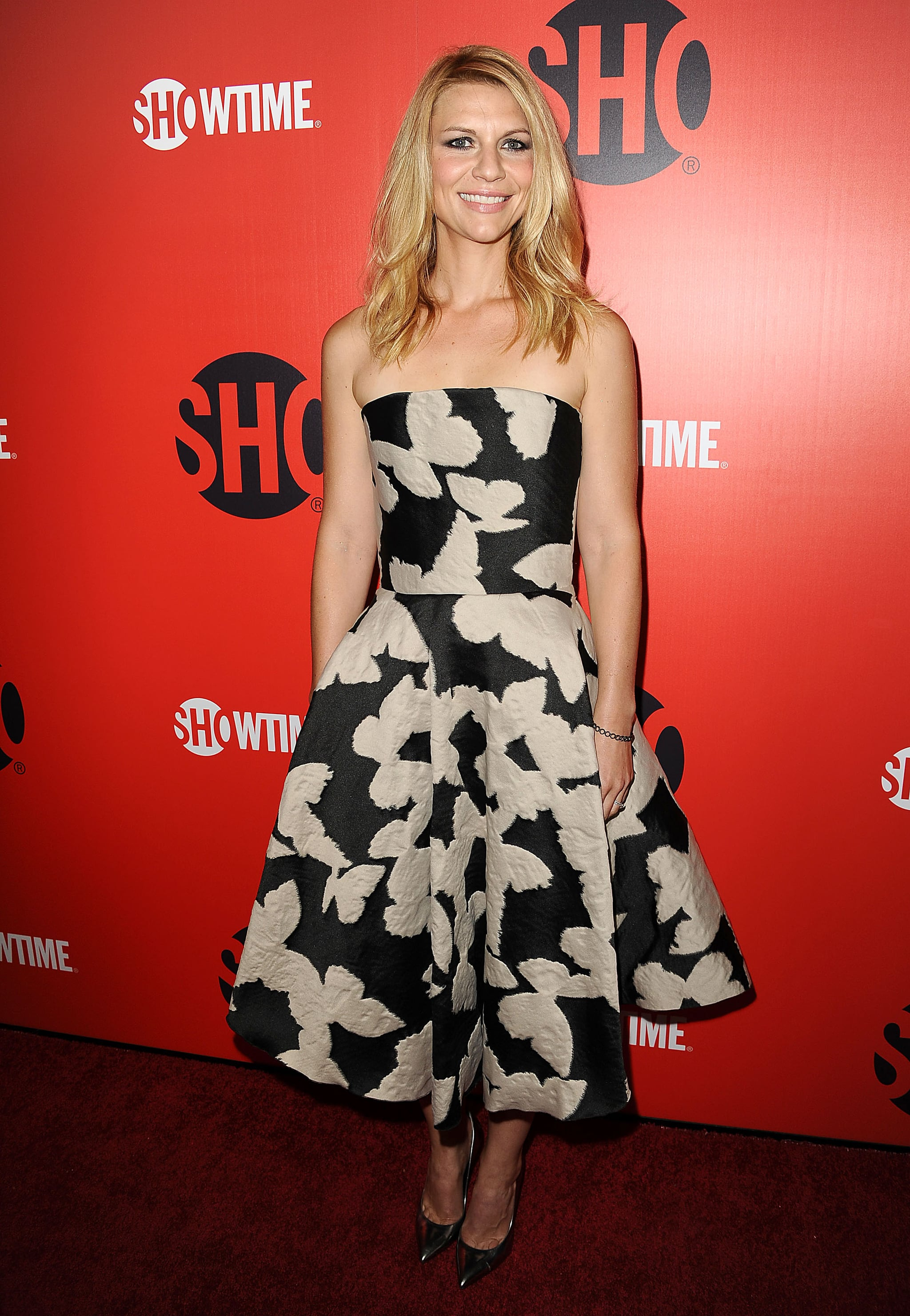 Claire Danes got glam in a strapless, printed fit-and-flare dress, metallic pumps, and Dana Rebecca bracelets at the Showtime 2013 Emmy Eve Soiree in LA.