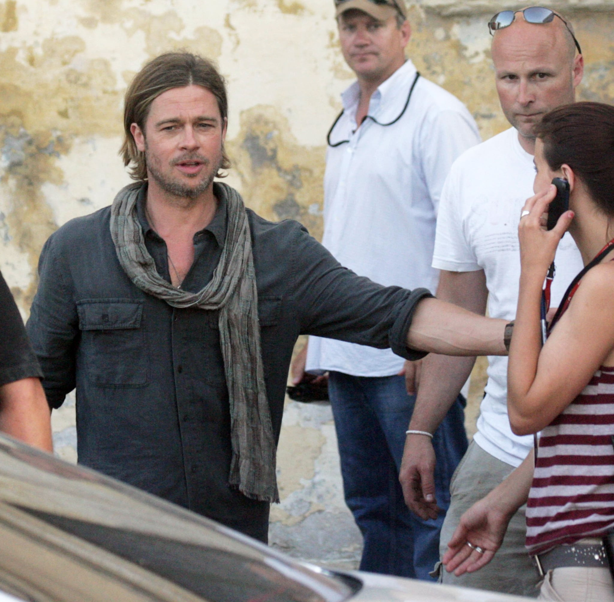 Brad Pitt joked with a co-worker on the set.