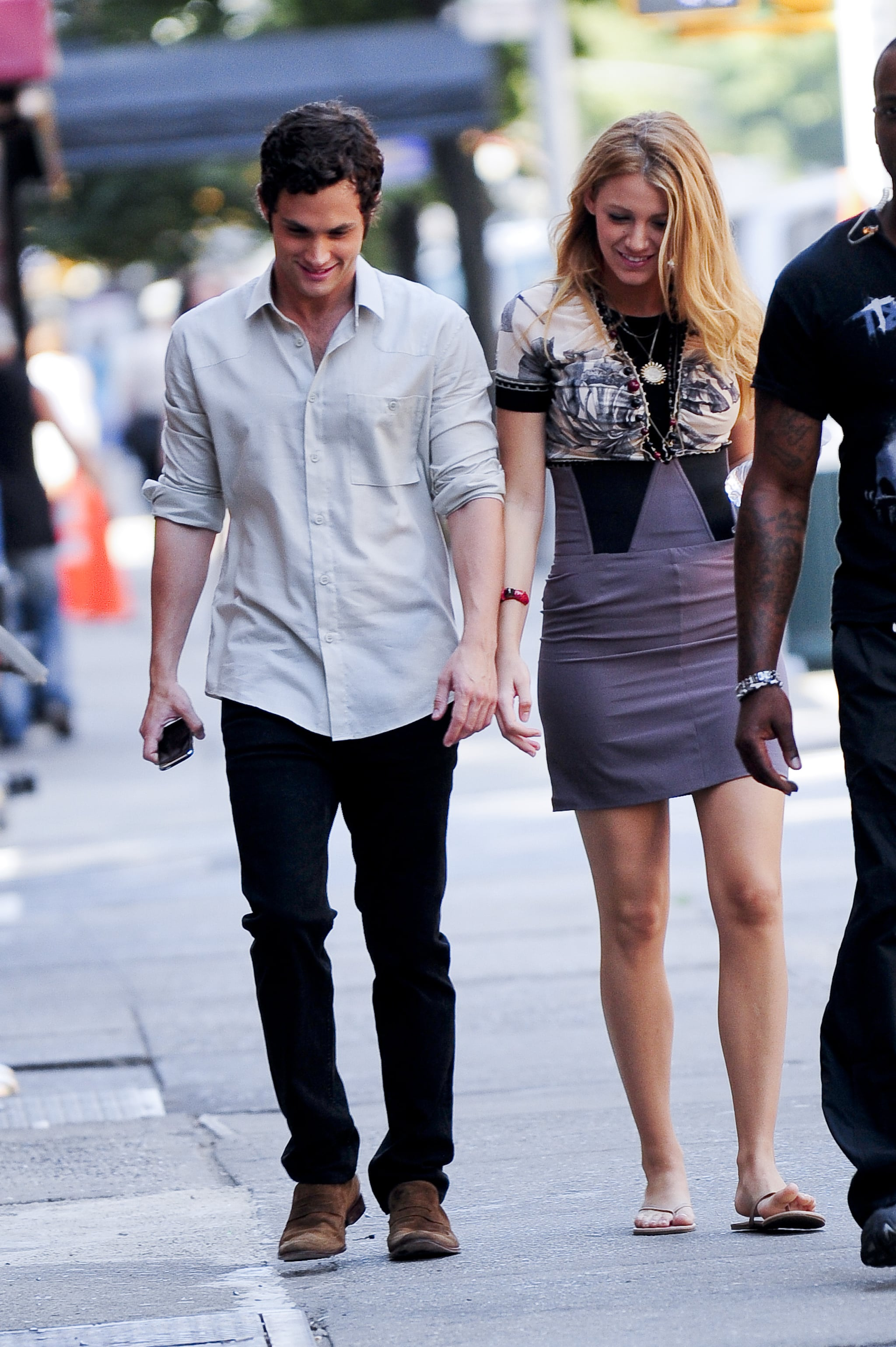 Then real-life couple Penn Badgley and Blake Lively walked to the set in August 2009.