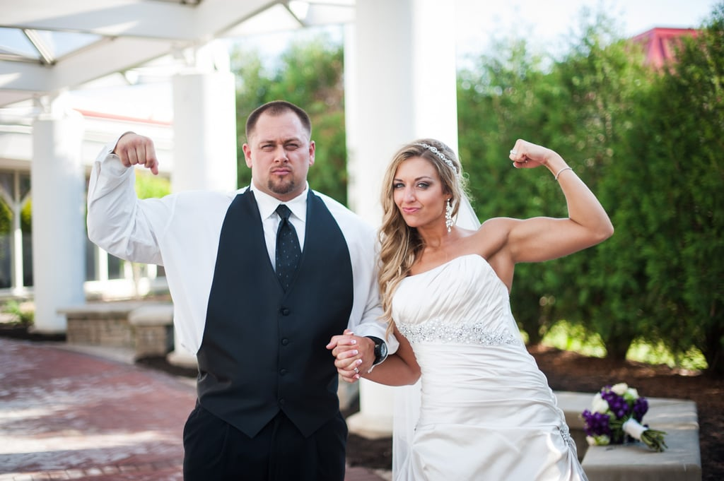 The happy couple held hands while showing off some serious guns.