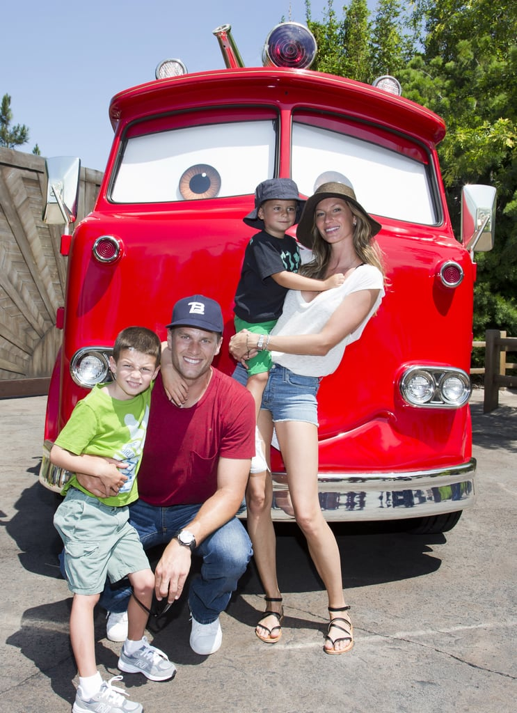 Tom Brady and Gisele Bündchen took their sons, Jack and Ben, to Cars Land at Disney California Adventure this week, where they posed with Red, the fire truck.