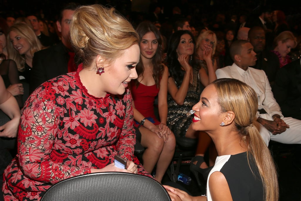 Beyoncé took a knee to chat with Adele during the 2013 Grammys.