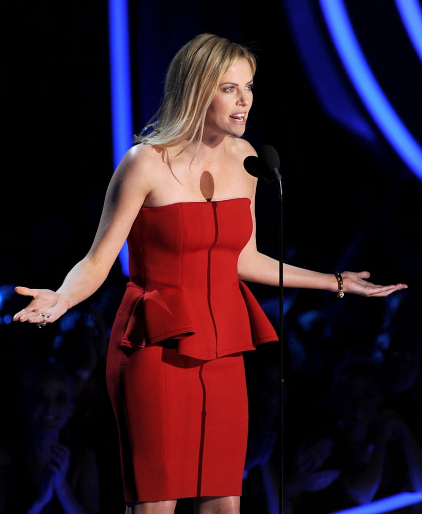 Charlize Theron wore a red Lanvin dress on stage.