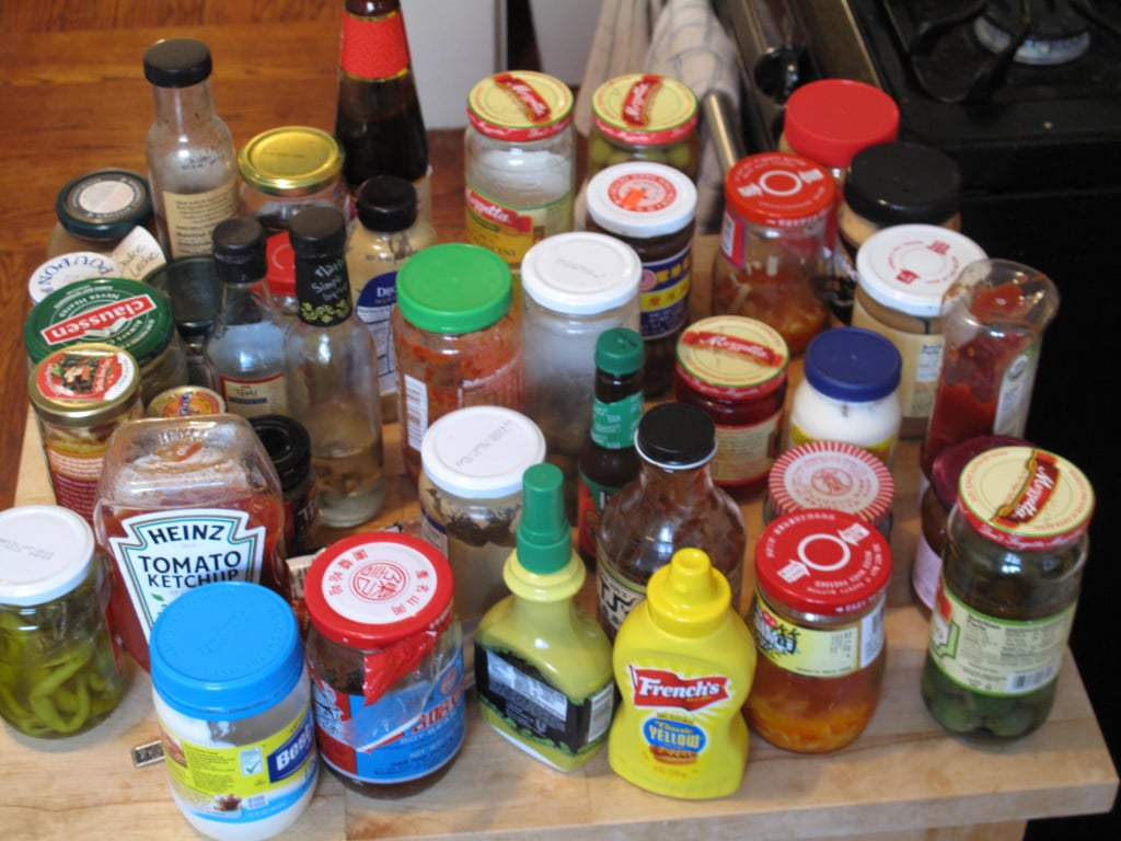 Pare down your condiments by throwing away those that look funny, smell weird, or have expired. Also get rid of other items that you know you're probably never going to use.