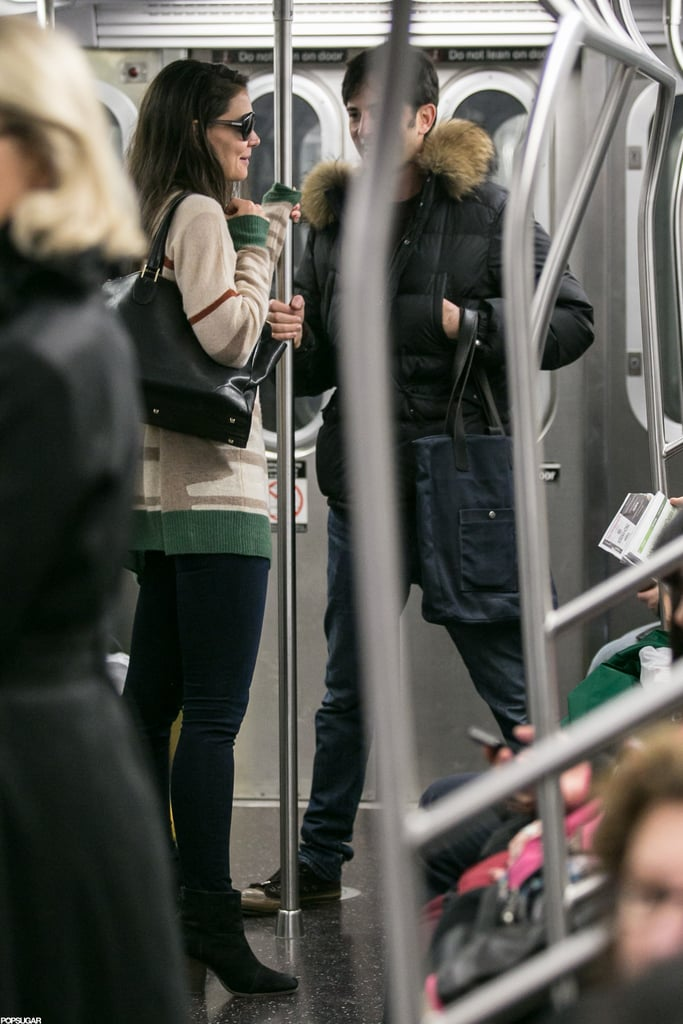 Katie Holmes rode the subway to her Broadway show with a male companion.