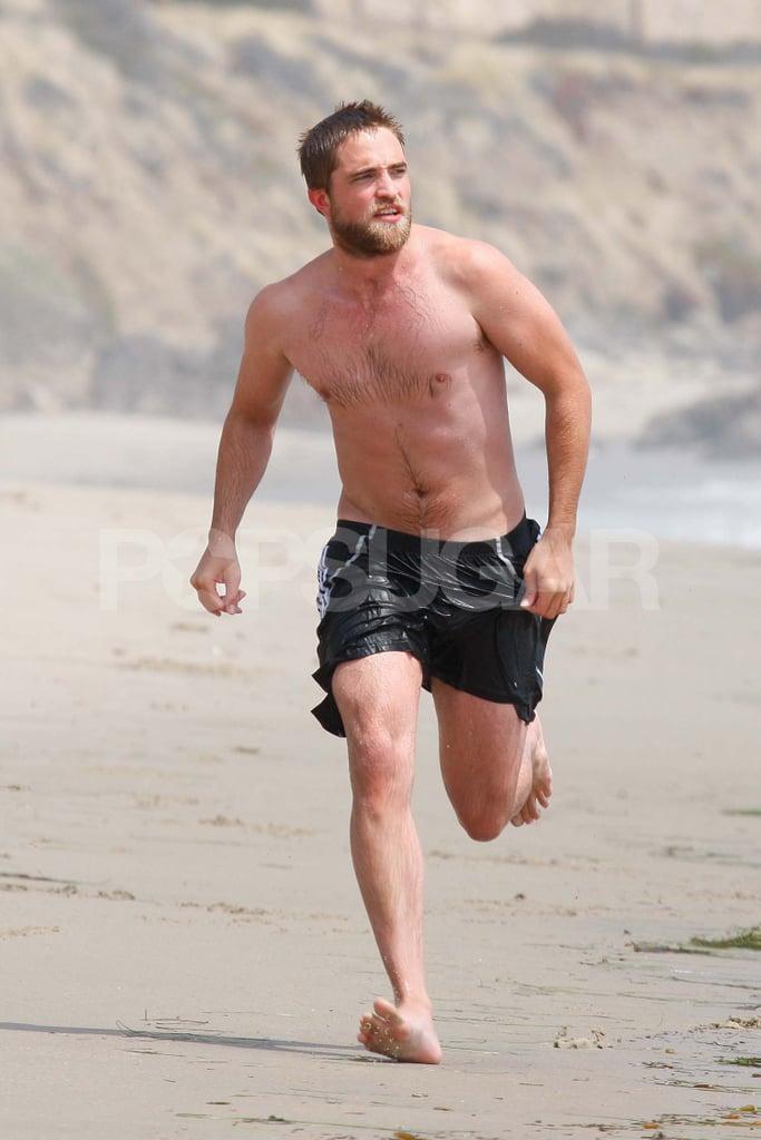 Robert Pattinson wore black shorts.