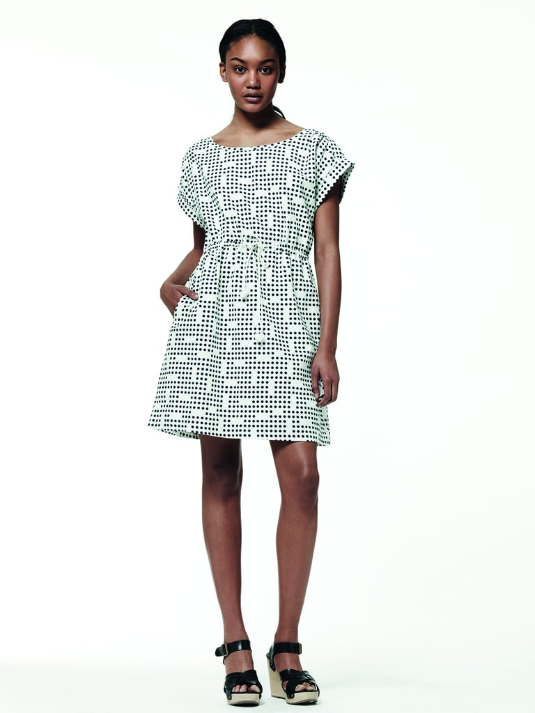 This printed shift dress gets its shape from the waist drawstring.