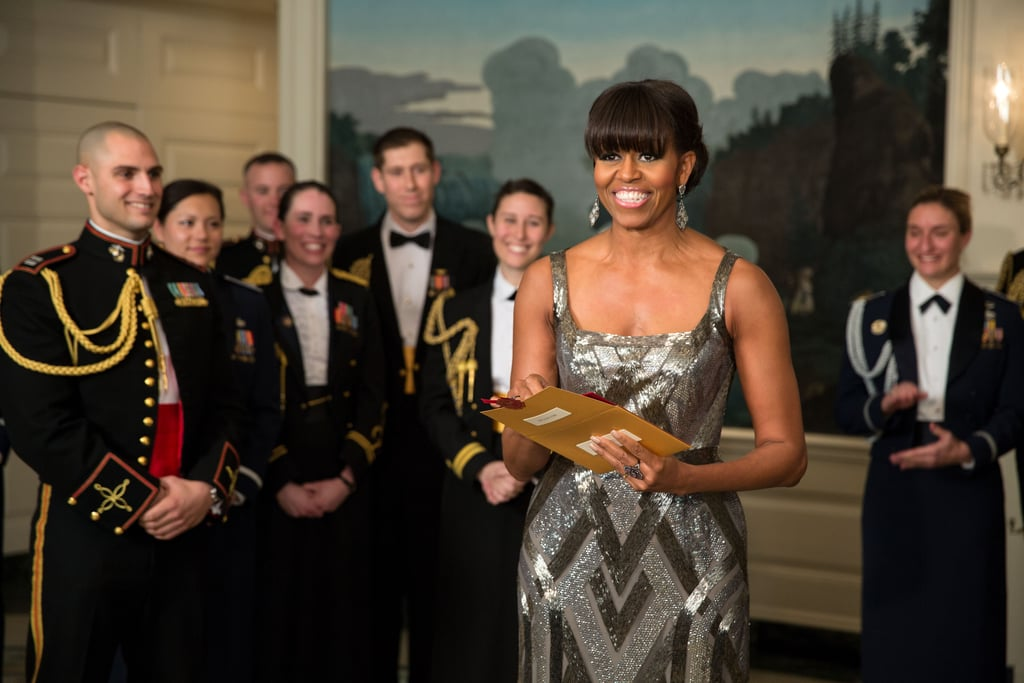 And the award goes to . . . Michelle Obama and her stunning custom-made silver art deco-inspired Naeem Khan gown on this year's Oscars night. She presented the award for best picture via satellite, and still managed to turn heads.