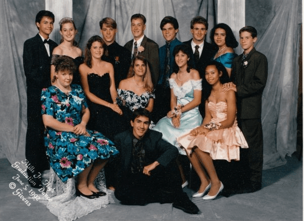 """""""Oh, the '90s! Floral prints and satin ruffles. You can't tell because of the girl in front of me, but my dress is covered in teal sequins [pictured back row, right]. I still own the dress and plan on wearing it when I turn 40. I'm pretty sure it's going to be back in by then."""" — Sabrina Eldredge"""
