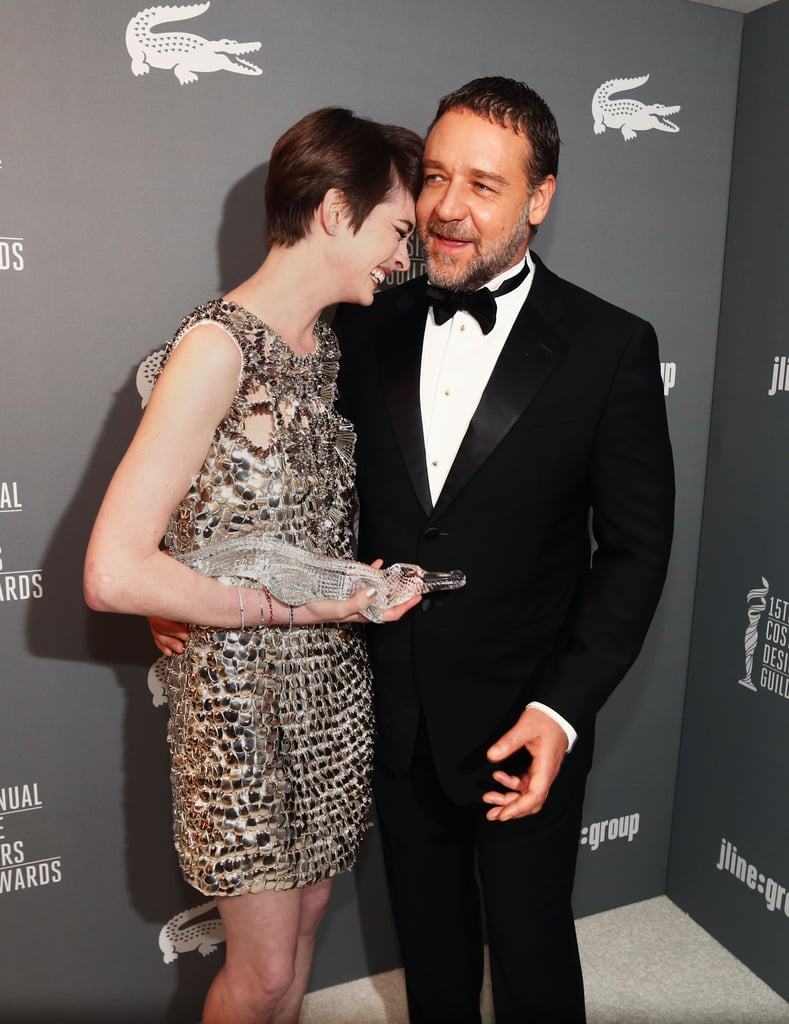Russell Crowe was a shoulder for Anne Hathaway to lean on when she cracked up at the 15th Annual Costume Designers Guild Awards on February 20.