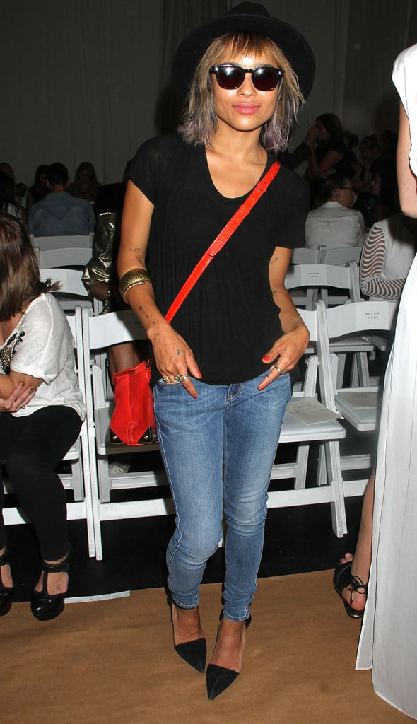 Zoe Kravitz kept it cool and casual in skinny denim, a black tee, pointy pumps, and a red crossbody bag at Sass & Bide.
