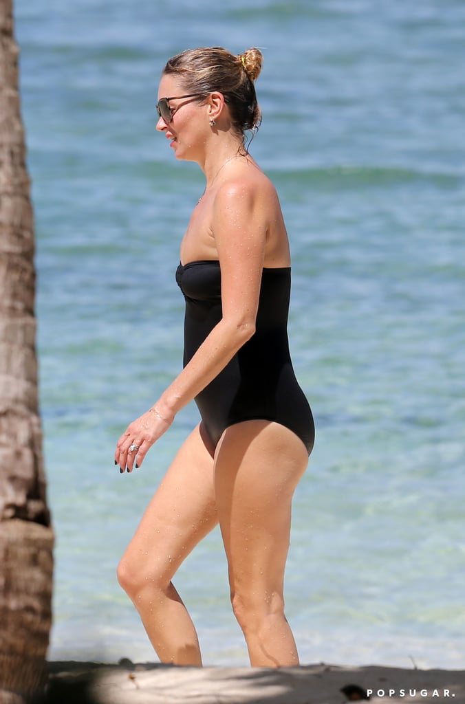 Kate Moss showed off her figure in a black strapless swimsuit.