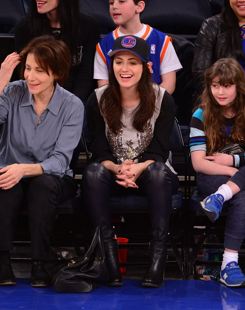 Emmy Rossum's never been shy about her basketball obsession, and this getup sends the message loud and clear. She fully embraced her team spirit with a classic basketball cap accenting her leather skinnies and embellished top.