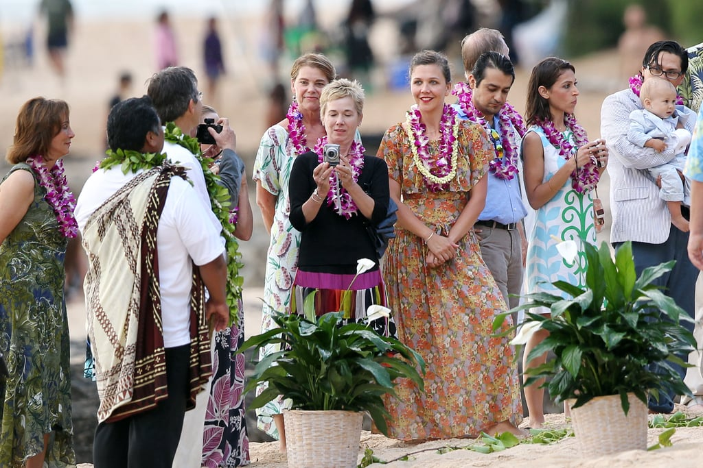 Maggie Gyllenhaal, along with her brother Jake Gyllenhaal, wore leis at their father's Hawaiian wedding party in July 2011.