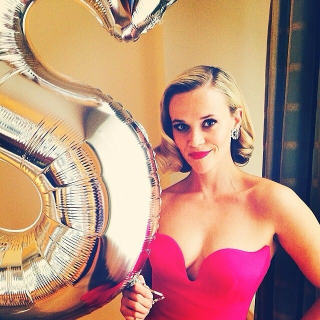 """Reese posed aside Stella's big """"S"""" balloon.  Source: Instagram user reesewitherspoon"""
