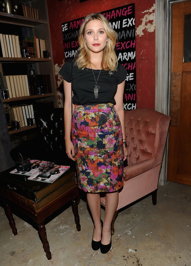 The actress went part bright, part dim in a floral pencil skirt and black accoutrements like a black tee and black suede pumps at a Nylon party in NYC. Note the unique brooch on her top.       Mid-length Skirts by Steffen SchrautPumps by Betsey Johnson