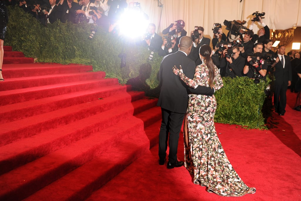 Kim Kardashian and Kanye West stopped to pose before heading up the staircase.
