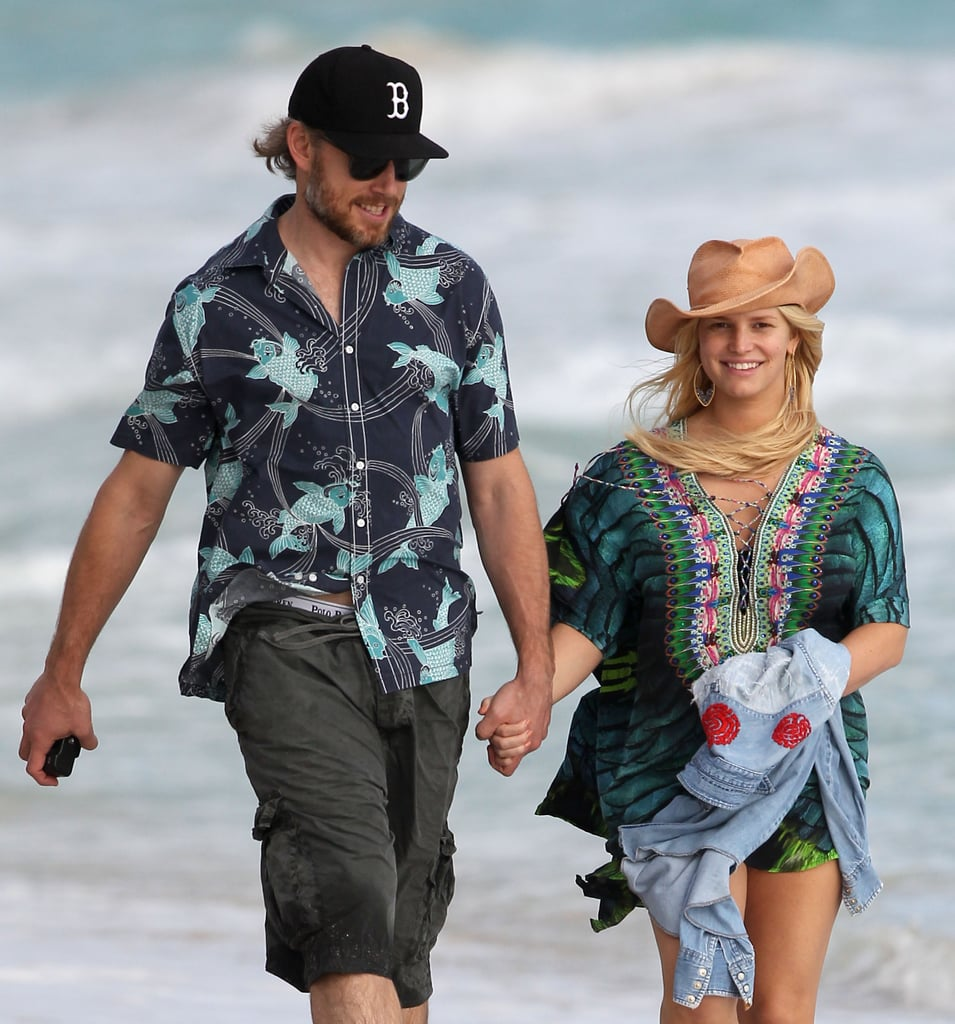 Eric and Jessica held hands while taking a walk on the beach in Hawaii back in December 2012.