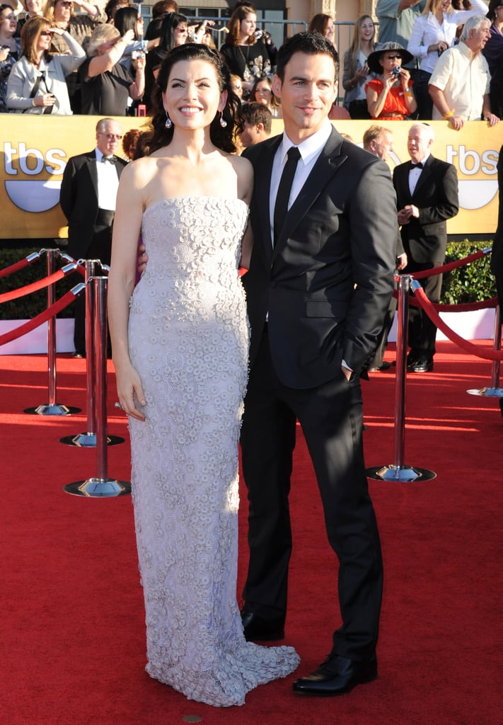 Julianna Margulies in a white gown with her husband at the SAGs.