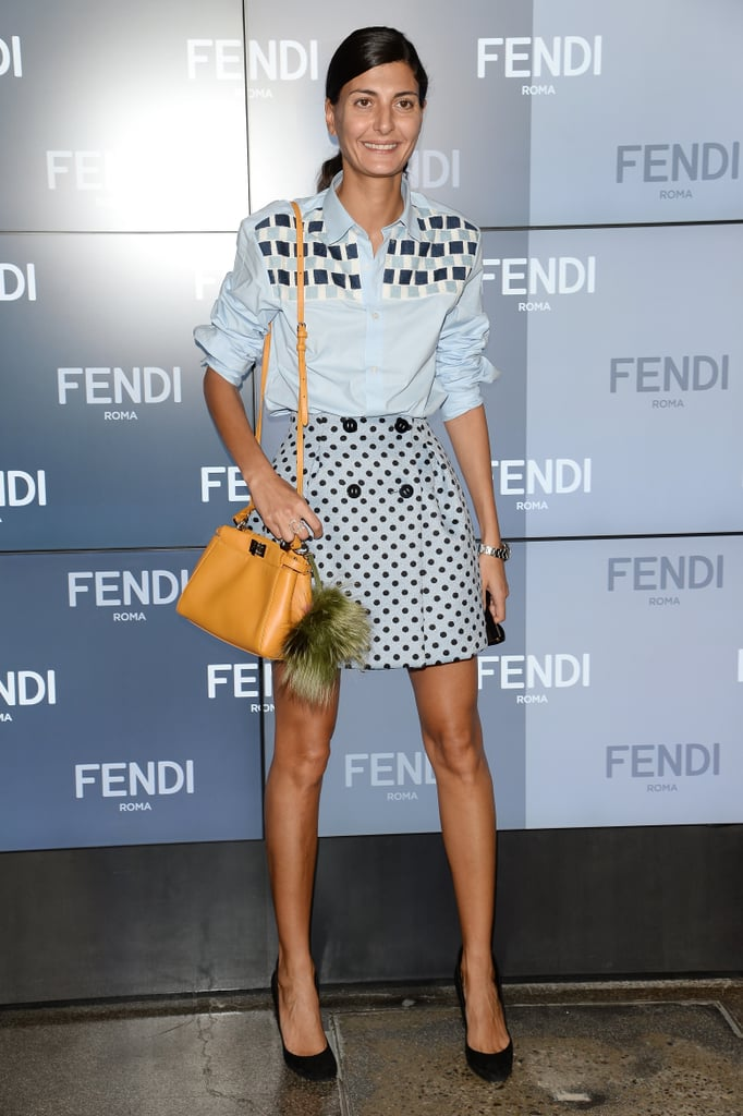 Giovanna Battaglia set off her prints with a autumnal tote for Fendi's runway.