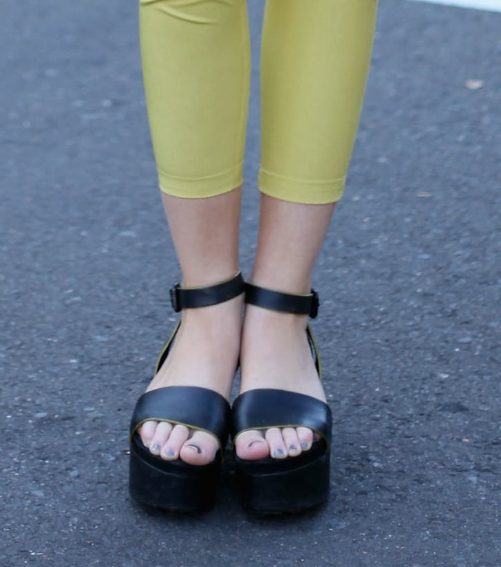 Make sure to zoom in on the neon yellow lining of these chunky ankle-strap flatforms.