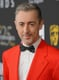 Alan Cumming rocked a brightly colored suit on the red carpet.