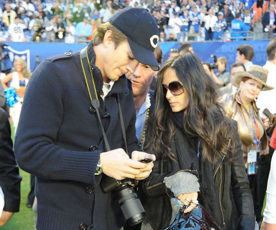 Demi Moore and Ashton Kutcher got ready for the game on the sidelines in 2010.
