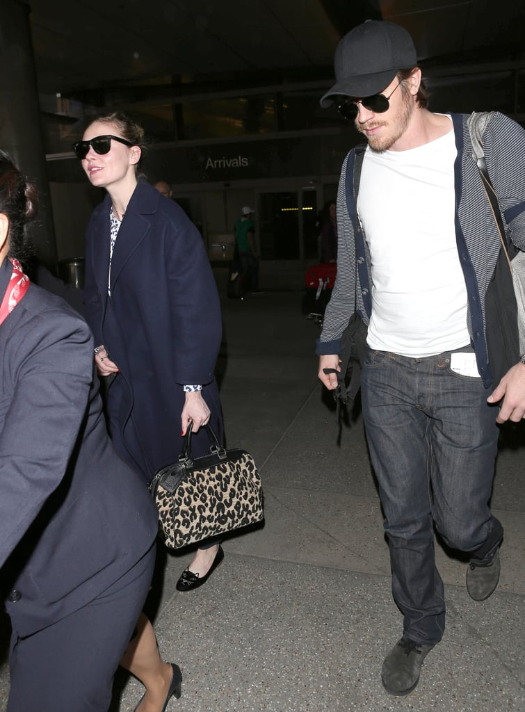 Garrett Hedlund wore sunglasses and a baseball cap when he and girlfriend Kirsten Dunst landed in LA.
