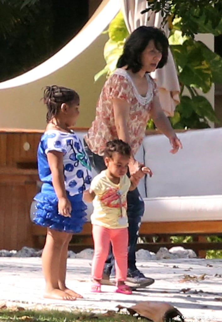 Blue Ivy Carter walked around by the pool.