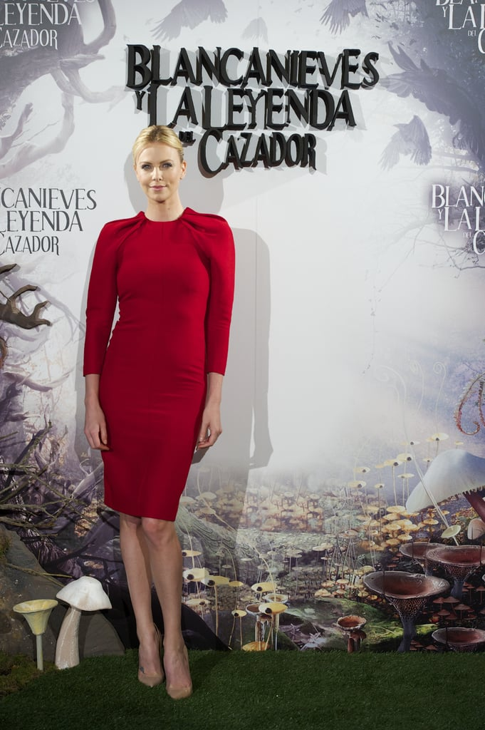 Charlize Theron dazzled in a red Giambattista Valli dress at the Snow White and the Huntsman photocall in Madrid.