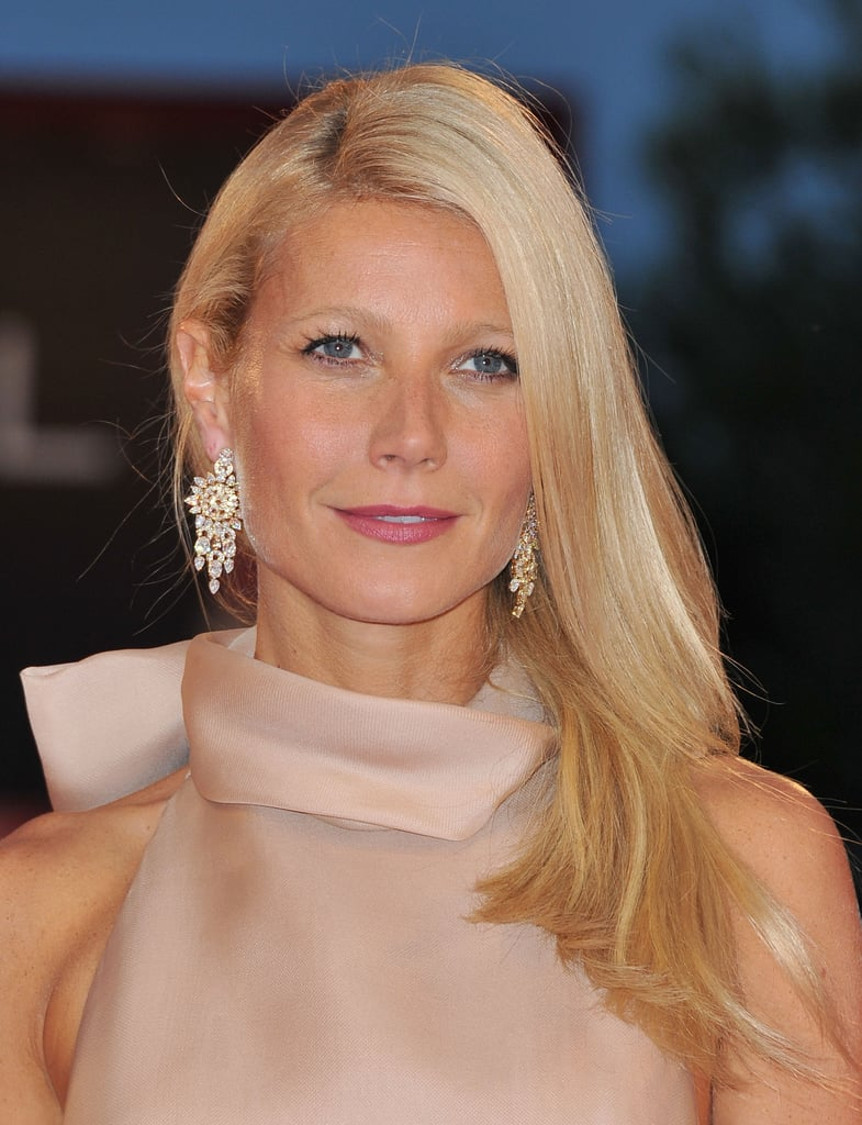 At the 2011 premiere of Contagion, Gwyneth's bronzed complexion and golden strands paired perfectly with a pop of pink lipstick.