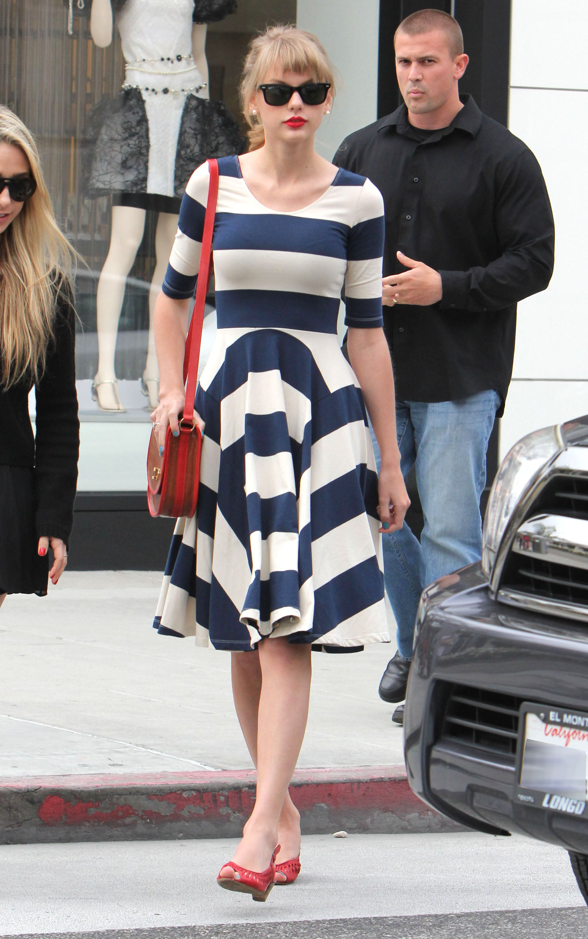 For a dressier vibe, start with a navy-and-white striped dress, then throw in lots of red via a bag, sandals, and lips à la Taylor Swift.