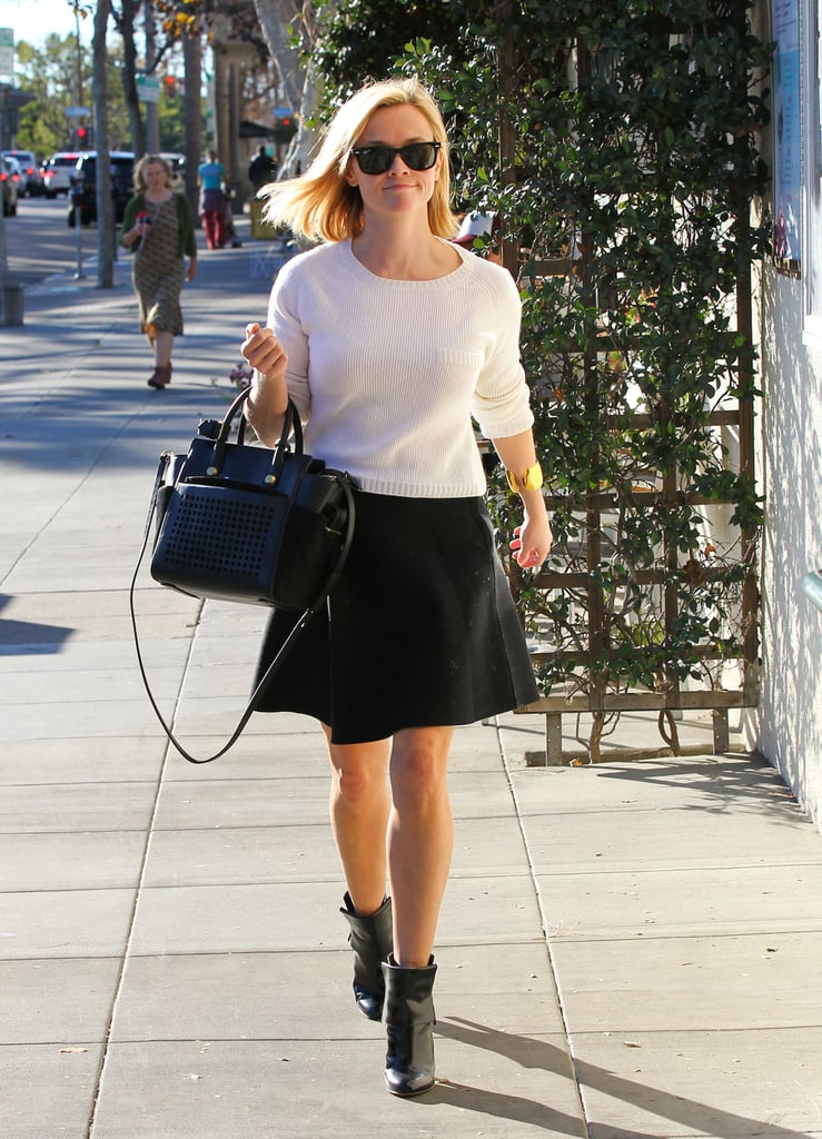 Witherspoon updated her black-and-white duo with patent Gianvito Rossi booties and a perforated Reed Krakoff tote.