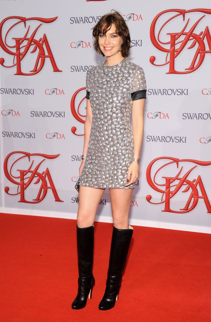 Arizona Muse rocked a textured mini with knee-high black boots.