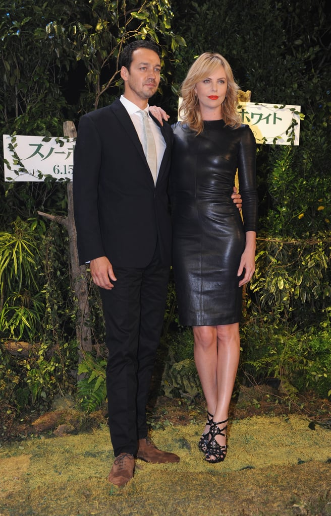 Charlize Theron attended the Tokyo press conference in a sexy fitted leather sheath by The Row. To keep the vampy look intact, she finished the look with Dior sandals and a bright red lip.