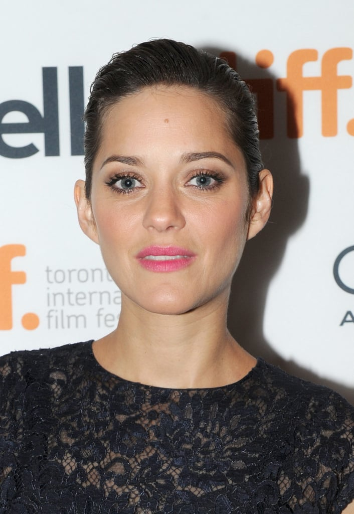 For her appearance at the Blood Ties premiere, Marion Cotillard went with a sleek updo and a pop of pink on her lips.