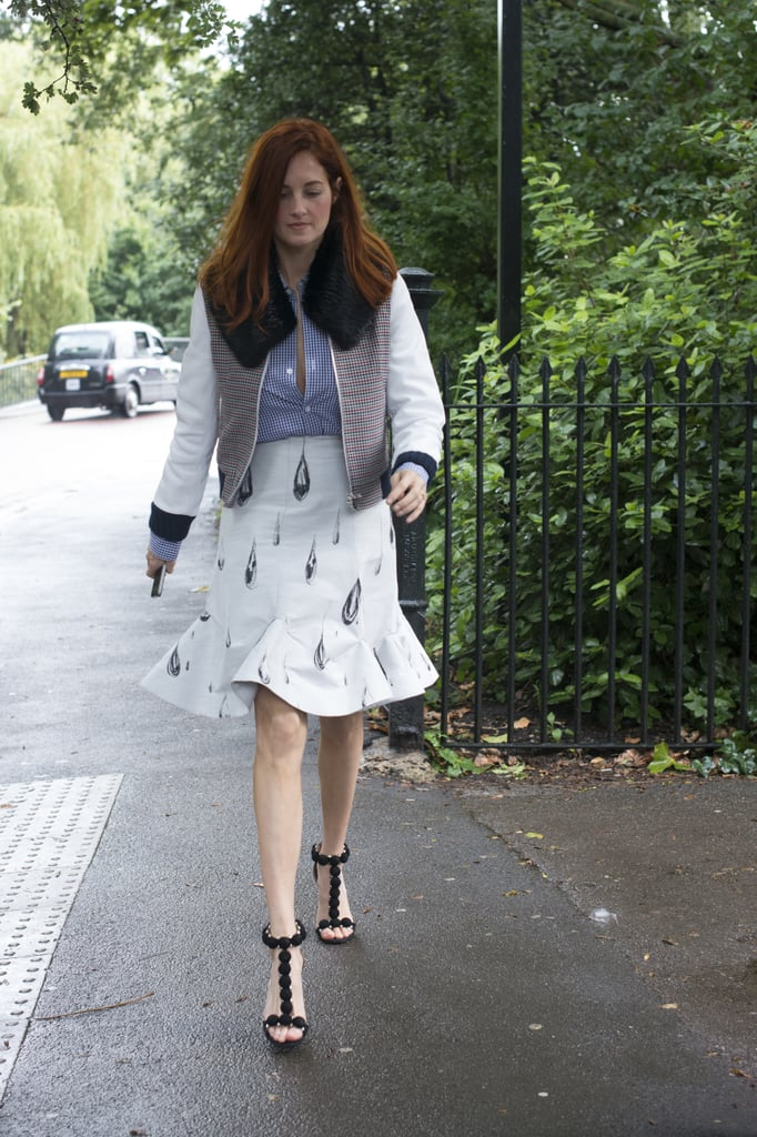 Taylor Tomasi Hill looked perfectly outfitted for a day in London, with a varsity jacket to top her butt-down and fluted skirt.