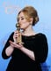 Adele kissed her Globe in the press room after winning best original song in a motion picture for Skyfall.