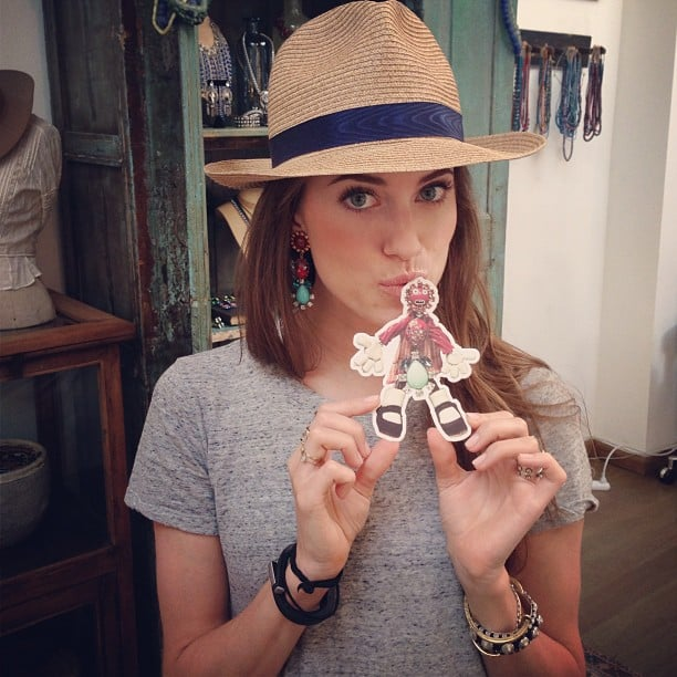 """Allison Williams hung out at the Dannijo store and posed with their mascot, """"Eddie the Earring."""" Source: Instagram user dannijo"""