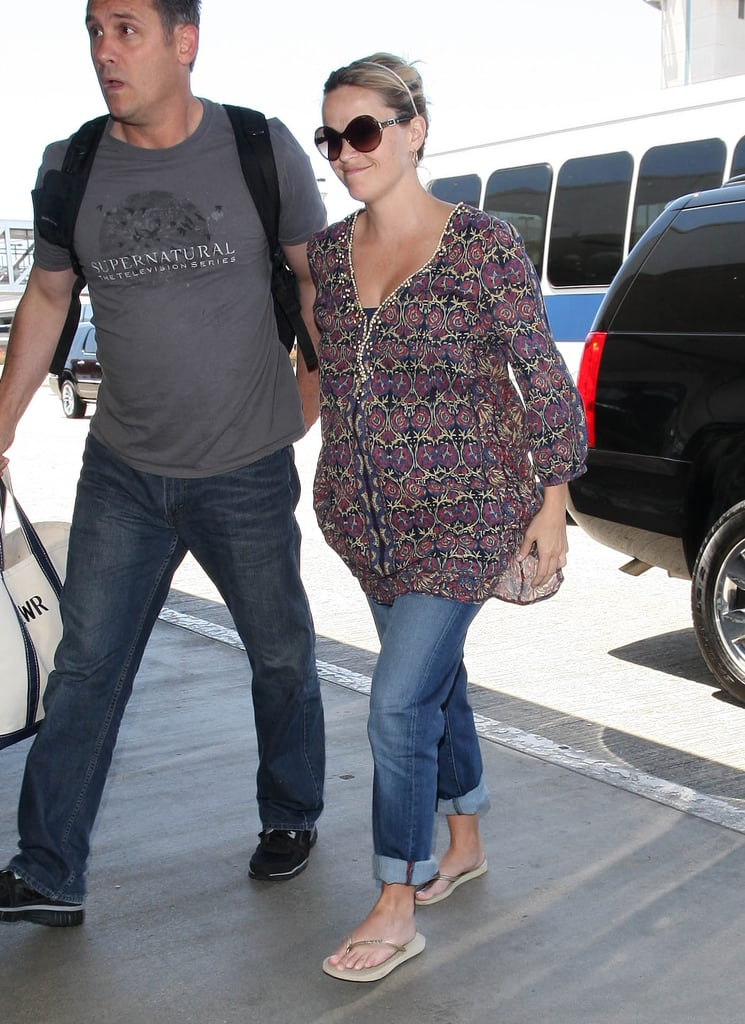 Reese Witherspoon was all smiles as she stepped onto the curb at LAX.