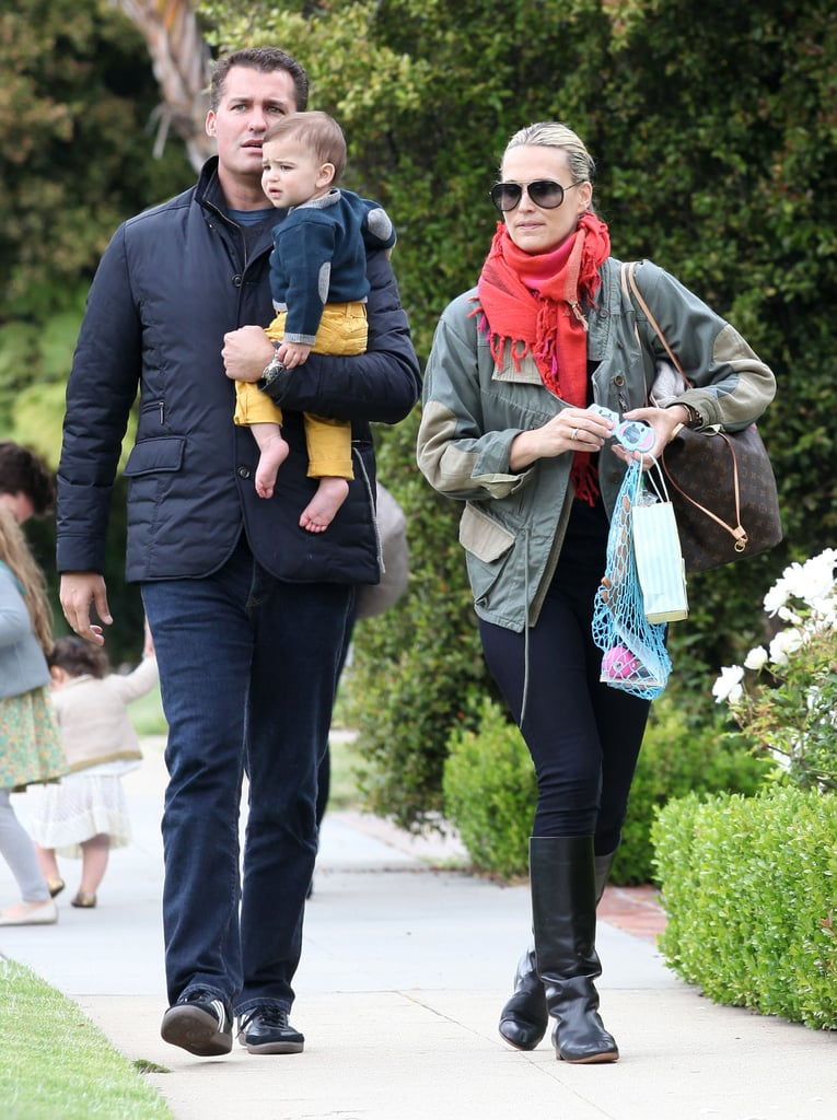 Molly Sims and her husband Scott Stuber took their son Brooks to a party at Rachel Zoe's house in LA on Sunday.