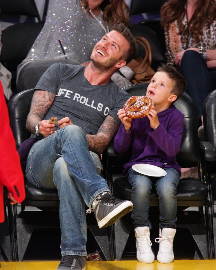 Cruz Beckham ate a humongous pretzel at the Lakers game with dad David Beckham.