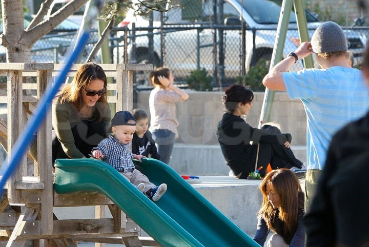 Jade Duell helped baby Robert down a slide while Owen Wilson watched.