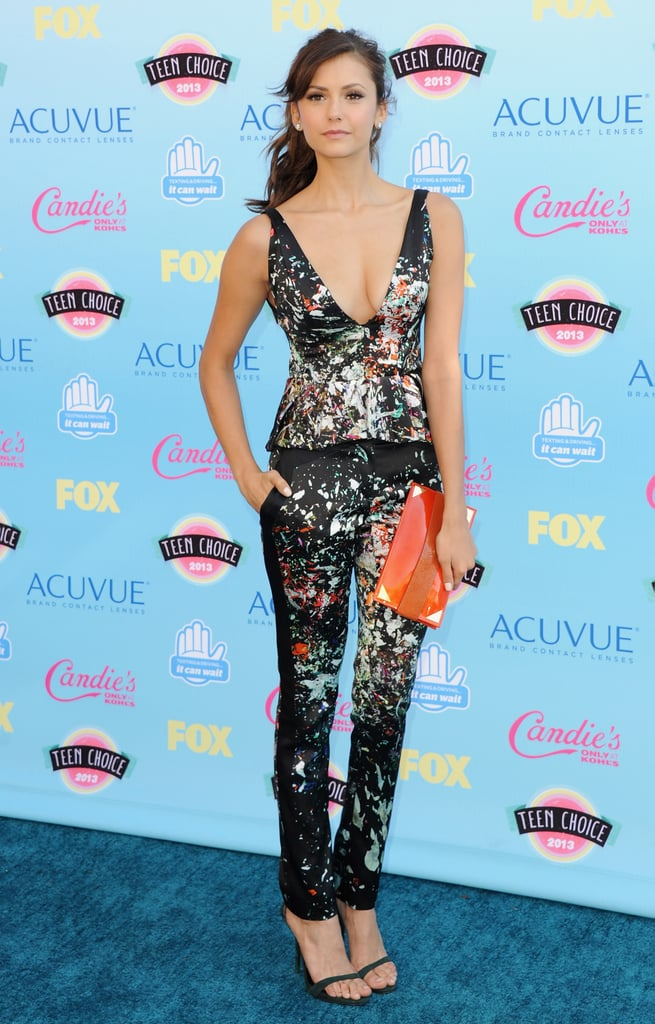 This girl knows how to rock a fun print. She wore a low-cut J. Mendel floral set to the 2013 Teen Choice Awards.