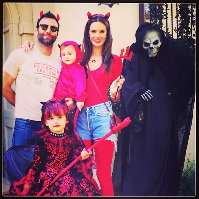 Alessandra Ambrosio and her family —fiancé Jamie Mazur and kids Anja and Noah —all dressed as devils. Source: Instagram user alessandraambrosio
