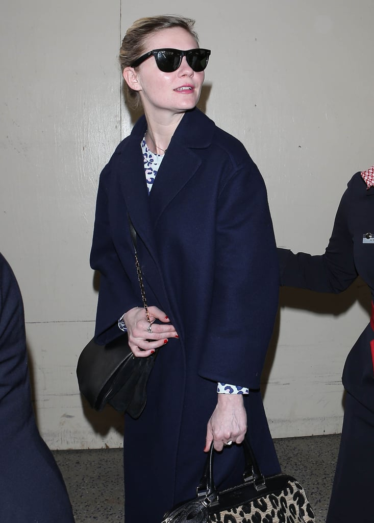 Kirsten Dunst wore black sunglasses and carried a leopard-print bag in LA on Wednesday.