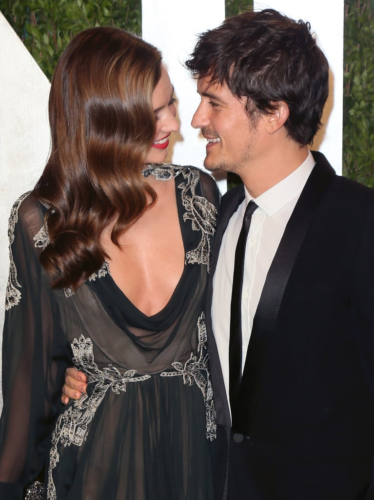 Miranda Kerr and Orlando Bloom shared a smile at the Vanity Fair Oscars bash in February 2013 in LA.