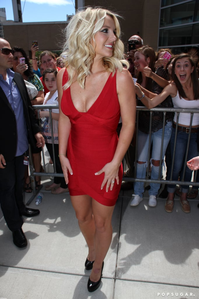 Britney Spears wore a bright red bandage dress.