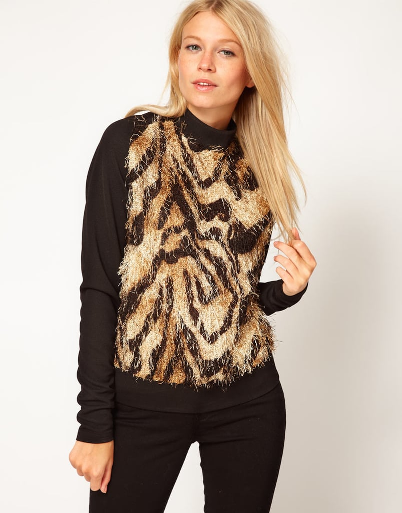The ASOS Woven Faux Fur Sweatshirt ($69) is a surefire conversation starter — pair it with black jeans or a pencil skirt.